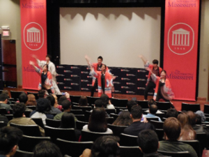 students dancing on a stage